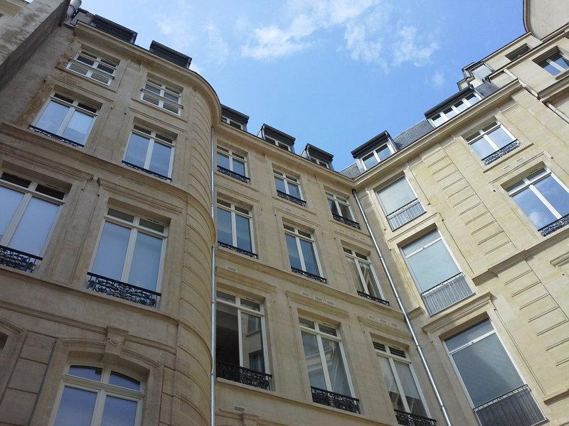 ravalement-facade-pierre-de-taille-immeuble-haussmannien